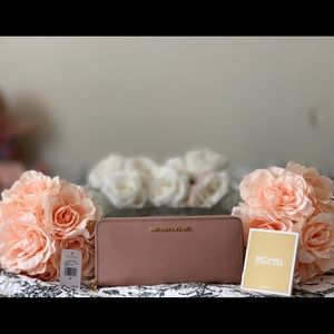 "Michael Kors leather wristlet in ""truffle""!"